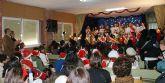 Padres y alumnos de los colegios de Puerto Lumbreras despiden el primer trimestre con una fiesta navideña