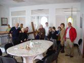 Los usuarios y profesionales del SED visitan la Cofradía del Santísimo Cristo de la Caída y elevación de la Cruz