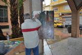 Pese a la lluvia m�s de 70 participantes se echan a la calle para participar en el V Certamen de Pintura al aire libre