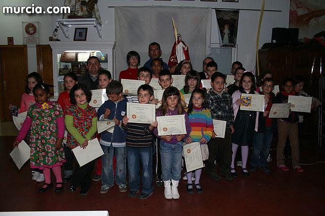 Homenaje a los portapasos infantiles de la Cofradía de San Juan Evangelista, Foto 1