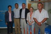 El senador Peñarrubia y la diputada del PP de Murcia, Cati Lorenzo, aseguran que hay que votar al PP para evitar m�s paro y el bloqueo de los trasvases