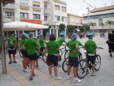 Escolares  de San Javier practican educación vial en bicicleta por las calles del centro en el día sin coches