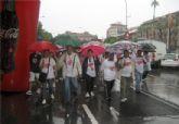 Decenas de personas participan en la marcha 'Unidos por un corazón sano' a pesar de la lluvia