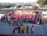 Los alumnos del colegio Joaquín Carrión forman un gran mapa de España con los colores de la bandera para celebrar la Constitución