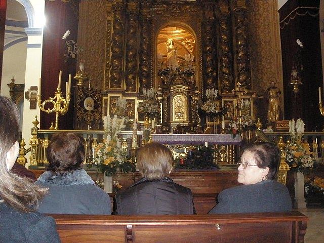 Los usuarios y profesionales del SED y del SEDA asistena a una misa celebrada en la iglesia de Santiago en honor Santa Eulalia, Foto 1