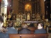 Los usuarios y profesionales del SED y del SEDA asistena a una misa celebrada en la iglesia de Santiago en honor Santa Eulalia