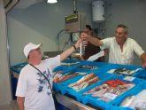 Los comerciantes del Mercado Cresta del Gallo promocionan sus productos