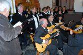 La misa de villancicos cantada por la Orquesta de Pulso y Púa 'Ciudad de Totana' y el 'Coro Amanecer' deleita al público asistente