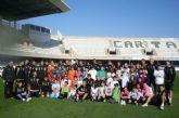 Alumnos del CP Beethoven y el FC Cartagena, juntos con el ADE