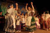 La Asociación de Coros y Danzas 'El Molinico Alguaceño' nombra Huertano del Año 2011 a la Junta Superior de Hermandades y Cofradías Pasionarias de la localidad.