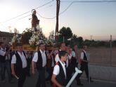 Los vecinos del barrio torreño de San Pedro sacan en procesión a su patrón