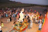 La virgen del carmen procesiona en Portmán