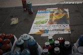 El arte urbano, la música y la fotografía transforman la calle Santiago en el foco de diversión juvenil de las fiestas de Santiago