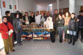 Autoridades municipales felicitan la navidad a los usuarios y profesores del Centro Ocupacional 'José Moyá ' y los del Servicio de Apoyo Psicosocial