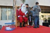Papá Noel recibe a decenas de niños en San Javier y Santiago de la Ribera