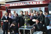 Los comerciantes de La Ribera Centro Abierto aprenden a cortar jamón con el campeón de España