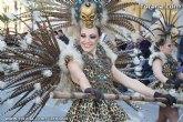 'La Musa' y 'Don Carnal' junto con las de peñas de carnaval impregnan de luz, color y ritmo las calles de Totana con el desfile de adultos