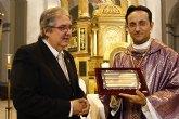 La Agrupación del Jesús Nazareno otorga el título de Hermano de Honor de la Agrupación y Nazareno de Honor 2012 al reverendo D. José Manuel Martínez Rosique