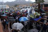 La 'Virgen del Milagro' desafía la lluvia en su llegada a Mazarrón