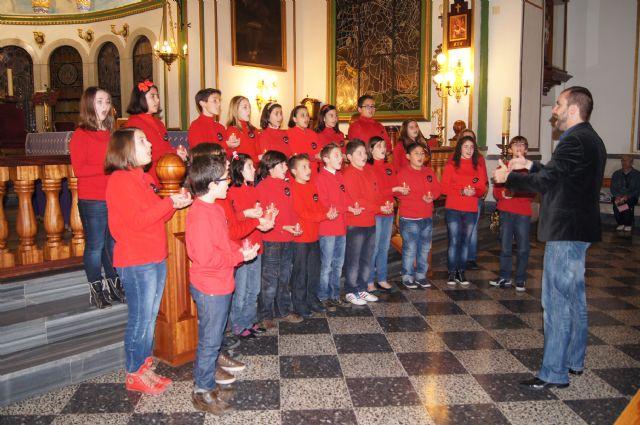 "The Choir School CEIP ""Santa Eulalia"" held a Christmas concert in the parish of ""The Three Hail Marys"", Foto 1"