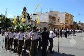 Los alumnos del San Pedro Apóstol trasladan en procesión la imagen de San Juan