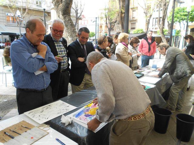 Los pintores Severo Almansa y Willy Ramos pintan en la puerta del Museo Ramón Gaya para conmemorar el Día Internacional del Libro - 1, Foto 1