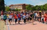 La tercera Carrera Solidaria del colegio Los Antolinos recauda más de 480 euros y 50 kilos de alimentos para Cáritas