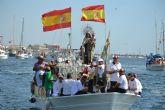Miles de fieles y pescadores acompañan a la Virgen del Carmen por tierra y mar
