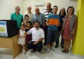 El 'Área Comercial Las Torres' entrega los 2.000 euros de su campaña de verano