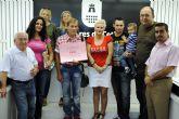 Las peñas torreñas entregan su premio de 2.000 euros de las Fiestas Patronales
