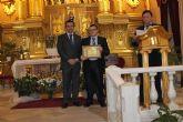 El Ayuntamiento de Archena entrega en un acto institucional y religioso el 'Escudo Oficial de la Villa' a la Virgen de la Milagrosa