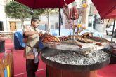 El agua no logra deslucir la apertura del Mercado Medieval