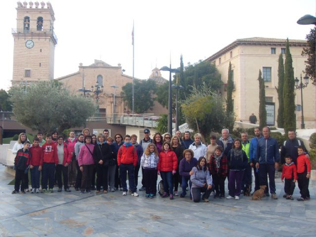 More than 60 people participated in the traditional framed Popular Walk the festivities in honor of Santa Eulalia