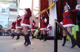 Papa Noël llega a Totana sumido en un espectáculo de música y animación