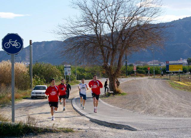 La plantilla de ElPozo Murcia realiza carrera continua por el Río Segura - 2, Foto 2