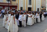 Los niños y niñas lumbrerenses que hicieron su Primera Comunión celebran la procesión del Corpus 2014
