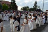 Niños de comunión procesionan en San Pedro y Lo Pagán con motivo del Corpus Christi