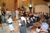 Lo Pagán celebra una ofrenda de flores y frutos en honor a la Virgen del Carmen