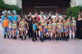 Niños y niñas del Club de Patín Totana realizan una exhibición de patinaje artístico en el parque municipal 'Marcos Ortiz'