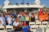 Un grupo de unos 60 voluntarios hacen batida de limpieza de playa en la zona de Veneziola