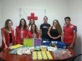 Jóvenes de IU colabora con la campaña de recogida de material escolar de Cruz Roja Juventud