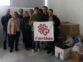 Las personas con discapacidad intelectual y sus familias donan alimentos, ropa y juguetes por medio de las asociaciones de FEAPS Región de Murcia