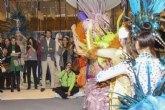 El consejero de Turismo invita a los visitantes del stand de la Región en Fitur a conocer los Carnavales de Águilas