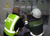 La Guardia Civil detiene a una veintena de personas por fraude de fluido eléctrico