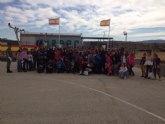 Escolares asisten a la parada militar del 58 aniversario del primer lanzamiento paracaidista de la Bandera Ortiz de Zárate III
