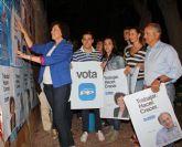 El Partido Popular de Puerto Lumbreras comienza la Campaña Electoral con la pegada de carteles