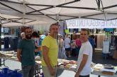 La  biblioteca municipal ofrece libros gratis en el mercado semanal de Santiago de la Ribera con su Mercado del Libro