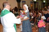 Vecinos de Lo Pagán honran a la Virgen del Camen con una ofrenda de flores y frutos