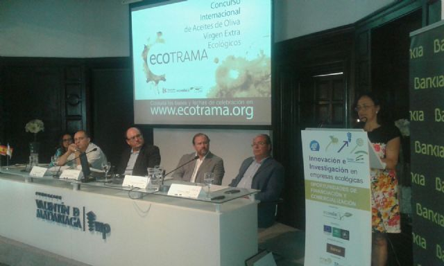 COATO Representatives of participating in a conference in Seville on innovation and research in green businesses.