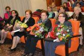 Las amas de casa homenajean a sus socias mayores en la fiesta de la Navidad